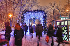 Walking people in winter park Royalty Free Stock Photo