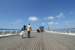 Walking the Pier Stock Photo