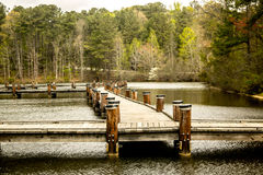 Walking Pier Over Calm Waters Stock Images