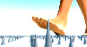 Walking on pins and needles Stock Photo
