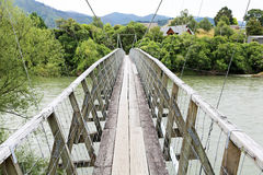 Walking on Pokororo swingbridge Royalty Free Stock Image