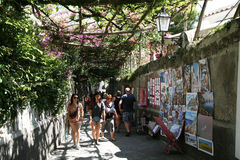Walking in positano. Tourists in the main street of positano on the amalfi coast in italy Royalty Free Stock Image