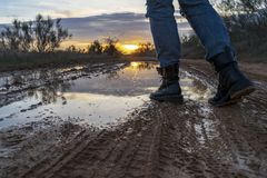 Walking through a puddle with military boots. royalty free stock photography