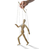 Walking puppet, . Puppet in the hands of puppeteer walks on , white background. Puppet is presented in business style with a tie royalty free stock image