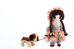 Heel Puppy, let`s go for a walk. New pose. Vintage girl rag doll with her puppy; presented on a plain white background. Stock Image