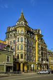 The quiet and cozy streets of Podil. Walking through the quiet and cozy streets of Podil, where you can not see a beautiful view. The pavement, fence, road, cars Royalty Free Stock Photography