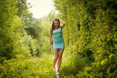 Walking on rail in tunnel of love Stock Photo