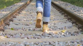 Walking on railroad track Stock Images