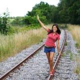 Walking on rails / railroad tracks Stock Photos