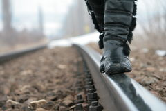 Walking on the railway. Woman in boots walking on the railway Royalty Free Stock Photography