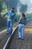 Walking on railway tracks Royalty Free Stock Photos