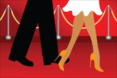Walking the red carpet. Man and woman walking along the red carpet Stock Photo