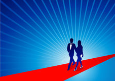 Walking the Red Carpet. A celebrity couple walk down the red carpet Royalty Free Stock Images