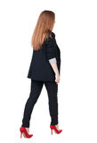 Walking red head business woman. Stock Image