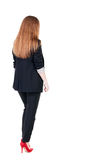 Walking red head business woman. Stock Photos