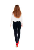 Walking redhead business woman. Back view. going young girl in  suit. Rear view people collection.  back side view of person.  Isolated over white background Royalty Free Stock Images