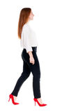 Walking redhead business woman. Stock Images