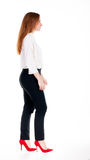 Walking redhead business woman. Royalty Free Stock Images