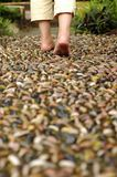 Walking on reflexology path. A foot reflexology path at garden,shallow focus on foot and stone Stock Photography
