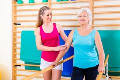 Walking Rehab in with senior woman Stock Photos