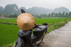 Walking on a rented motorcycle or motorbike in Asia Stock Image