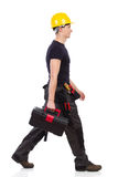 Walking repairman carrying toolbox Stock Photos