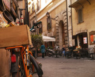 A Bicycle outside a shop and Cafe in Rome Stock Photo