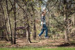 Walking on the rope. Activity and atraction outdoor in Borisova Garden in Sofia, Bulgaria Stock Photo