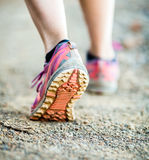 Walking or running legs, adventure and exercising. Walking or running legs on trail, adventure and exercising in mountains nature, dirt road stock photography