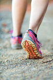 Walking or running legs, adventure and exercising. Walking or running legs on trail, adventure and exercising in mountains nature, runners sports shoe on dirt stock images