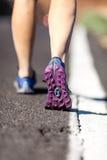 Walking or running legs on aspahlt road, adventure and exercising. Walking or running legs on asphalt road, adventure and exercising in summer nature.Female stock image