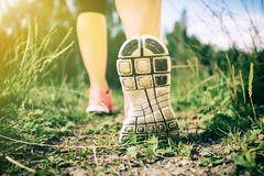 Walking or running legs in forest, adventure and exercising. Walking or running exercise, legs on footpath in forest, achievement fitness adventure and stock image