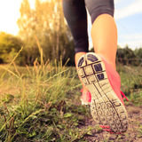 Walking or running legs in forest, adventure and exercising. Walking or running exercise, legs on footpath in forest, motivation inspiration concept outdoors Stock Photos