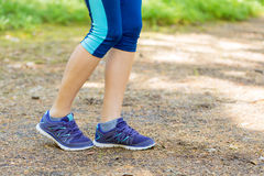 Walking or running legs in forest, exercising in summer nature.T Stock Photography