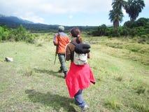 Walking safari. A tourist and a ranger in the arusha national park in tanzania in a dangerous walking safari stock image