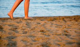 Walking on sand beach Royalty Free Stock Photography