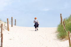 Walking through a sand dune Stock Images
