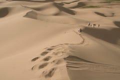 Walking on sand dunes stock image