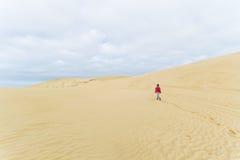 Walking on the sand dunes Stock Photo