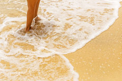 Walking on the sand. Walking on the sand by the sea Royalty Free Stock Photo