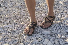 Walking in sandals on beach Stock Images