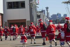 Walking santas. Royalty Free Stock Photo