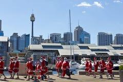 Walking santas during 'Santa fun run' Royalty Free Stock Photos