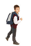 Walking school boy in a hurry Royalty Free Stock Photos