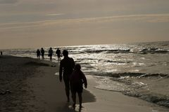 Walking by the sea. In sunset light Stock Photography