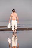Walking at sea coast. Man is walking at sea coast Stock Photos