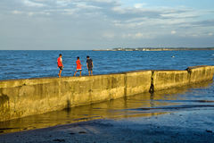 Walking on the sea wall Stock Images