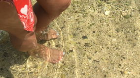 Walking in a shallow watter. stock video footage