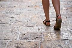 Female pedestrian on tiled street royalty free stock photos