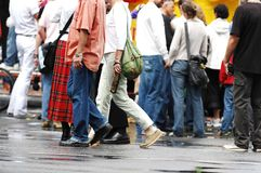 Walking shoes. Crowd of people at event, focus on the shoes Royalty Free Stock Image
